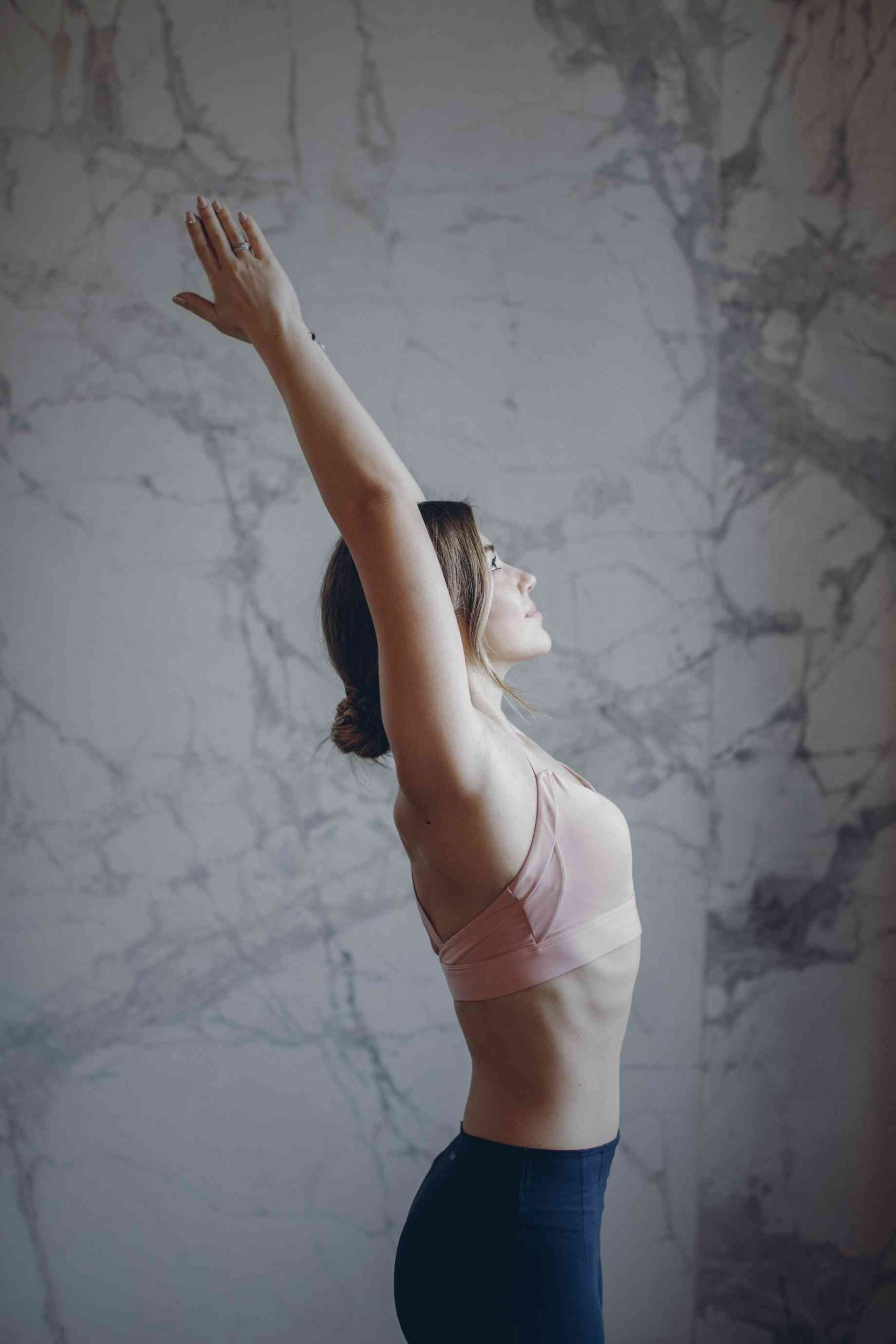 A Young Woman Practice Raised Arms Pose