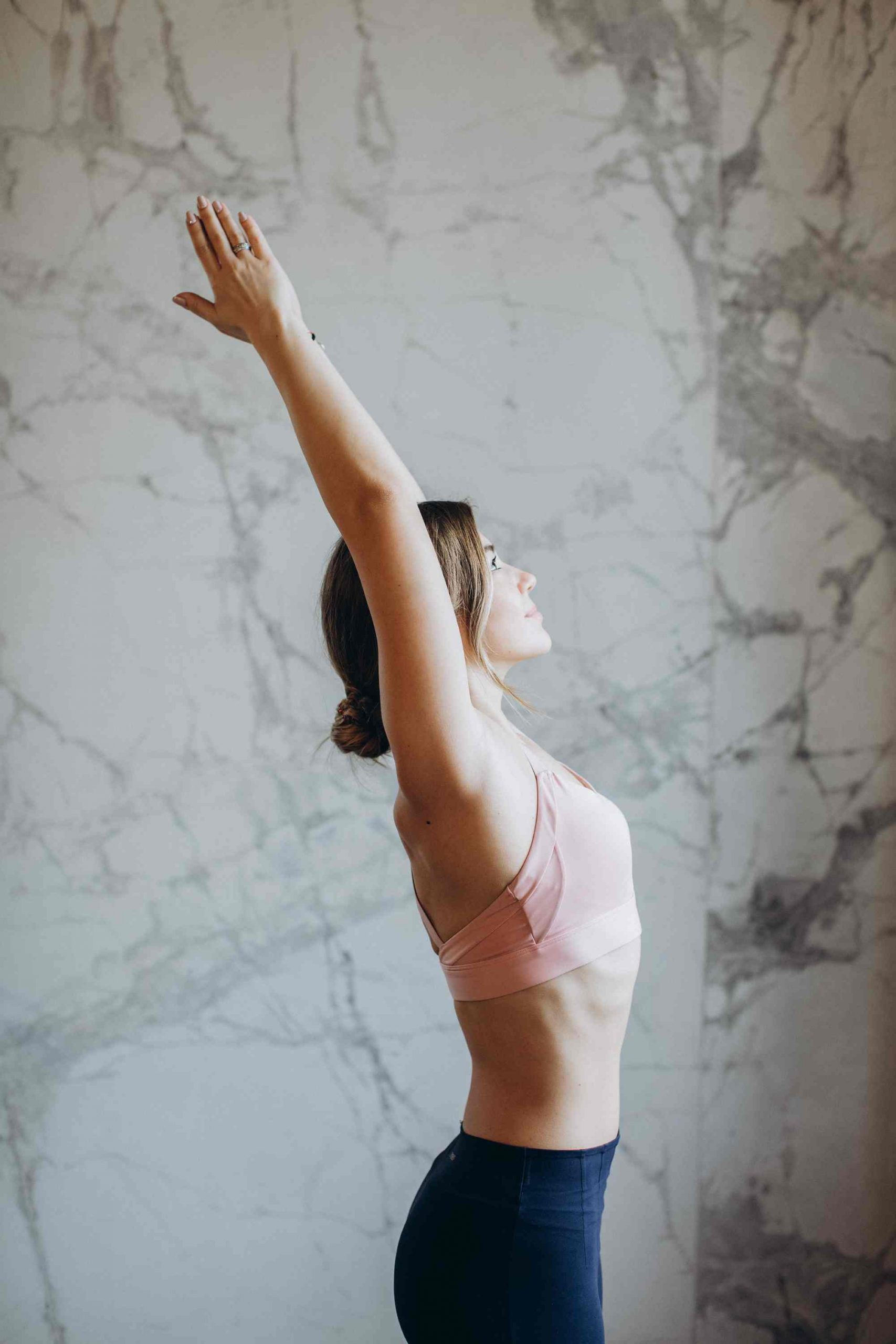 A Women in the Raised Arms Pose